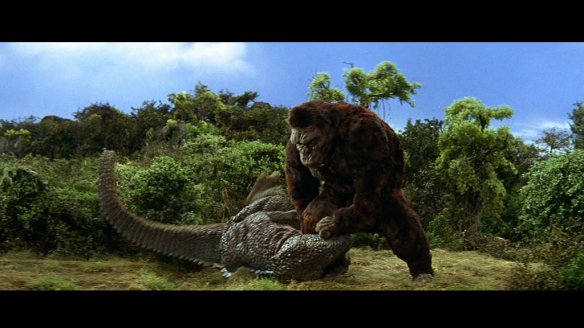King Kong punches out a dinosaur.